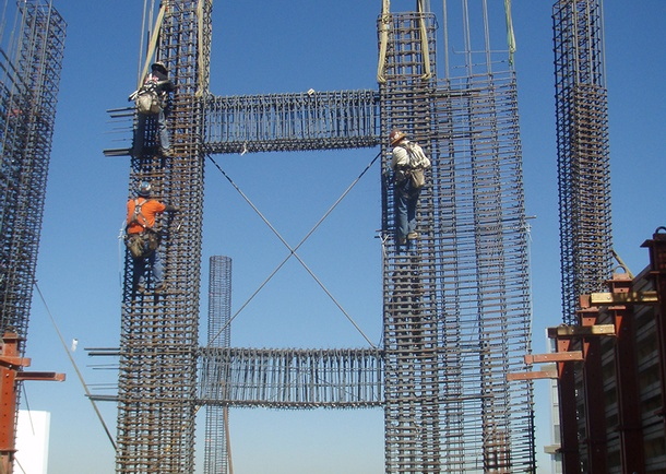 Shear wall reinforcing cage is secure; workmen are readying to release crane slings. Photo courtesy of Cary Kopczynski & Co